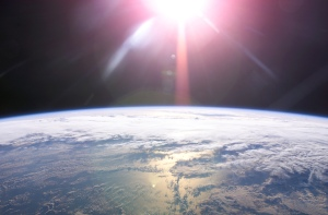 0124-0610-2617-4546_rising_sun_and_earths_horizon_from_space_o